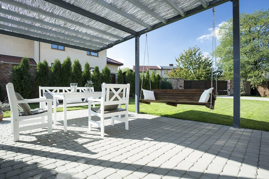 Beautiful patio with white table sitting and wooden swing