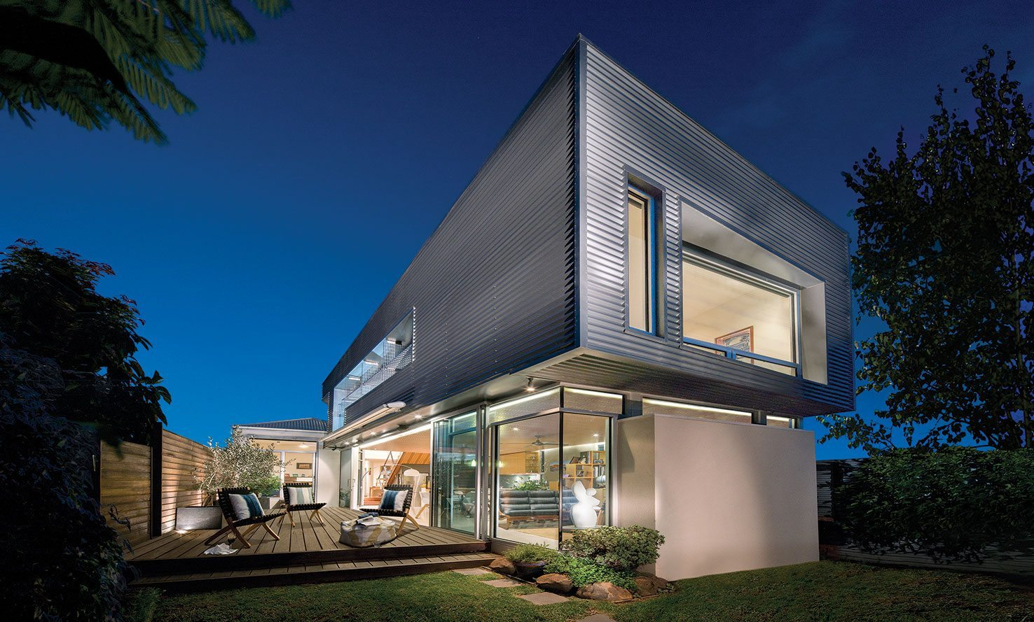 Beautiful metal sheeting duplex house in evening