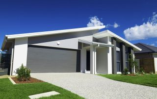 Front view of a new house with a modern roof.