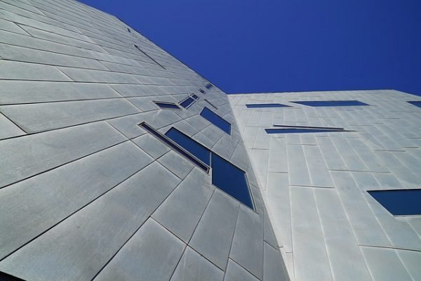 Example of modern cladding, grey metal cladding on new building showing asymmetrical windows and building exterior