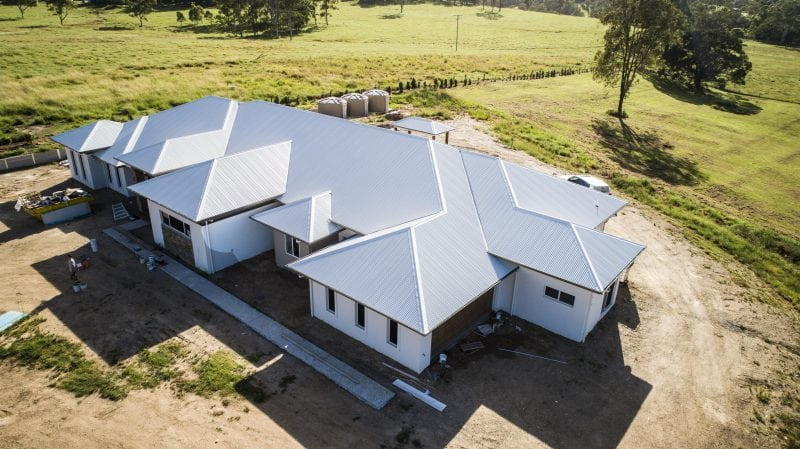 Aerial view of a home with modern metal roofing and walling