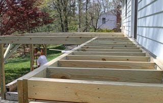 A partially built upper deck on a house