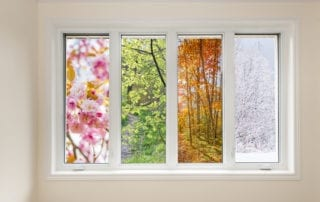 Window in home interior with view of four seasons