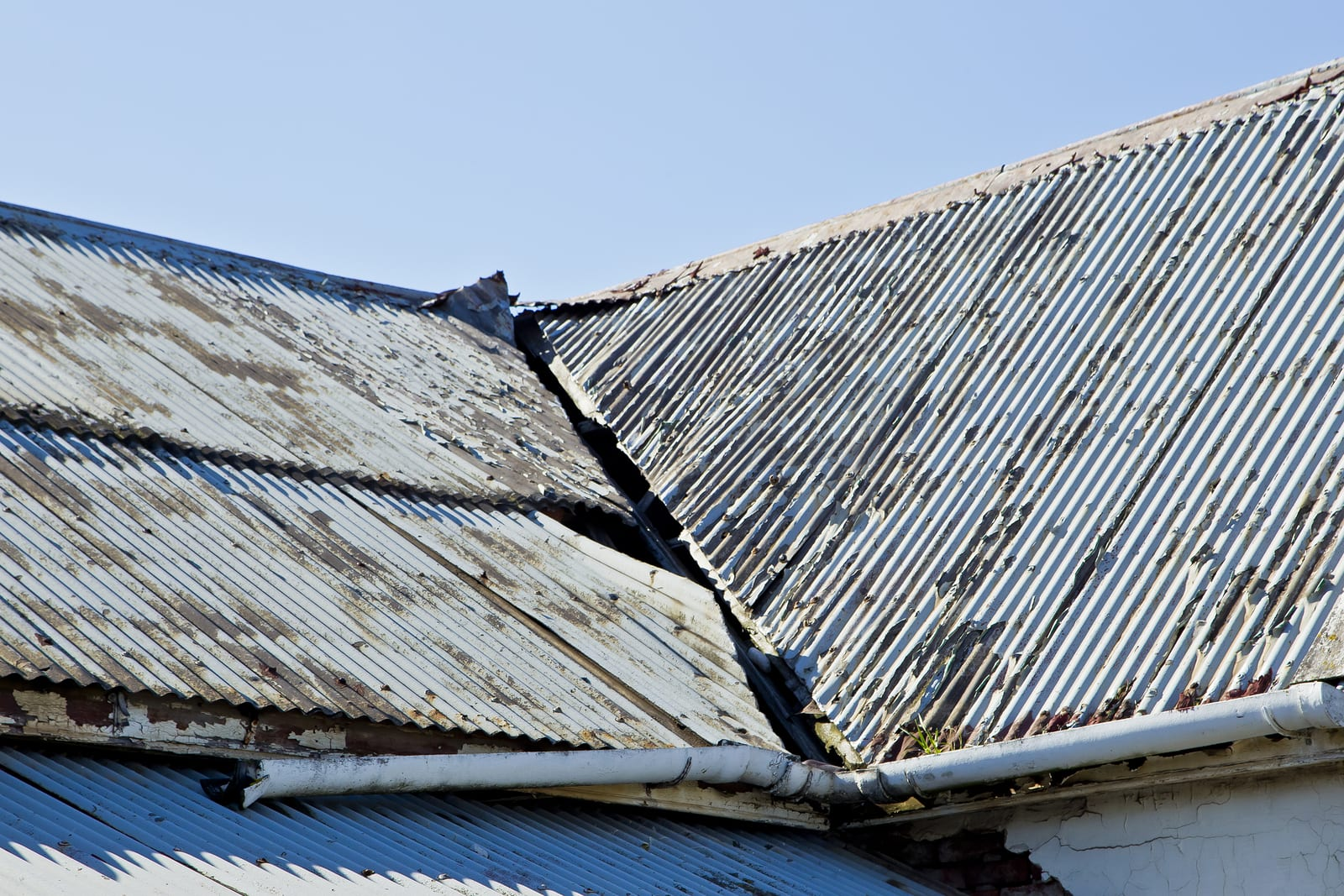 Broken corrugated iron roof sheets on an old abandoned house