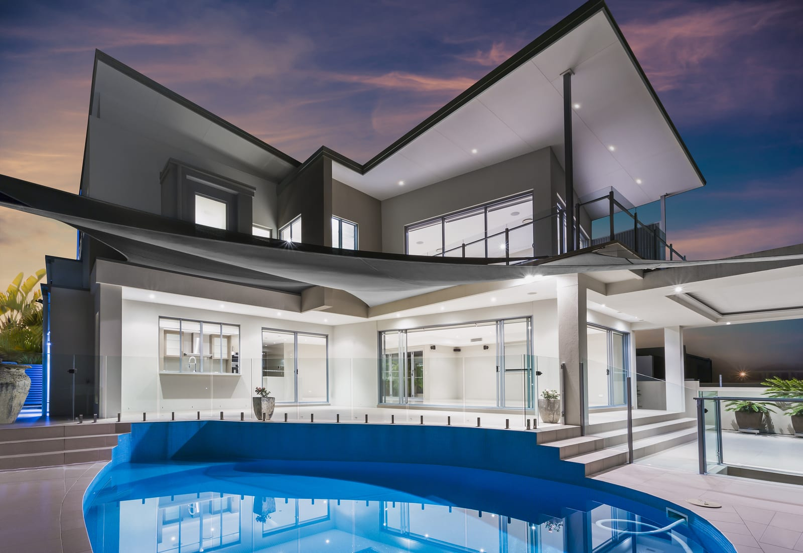 Exterior view of modern luxurious mansion with swimming pool